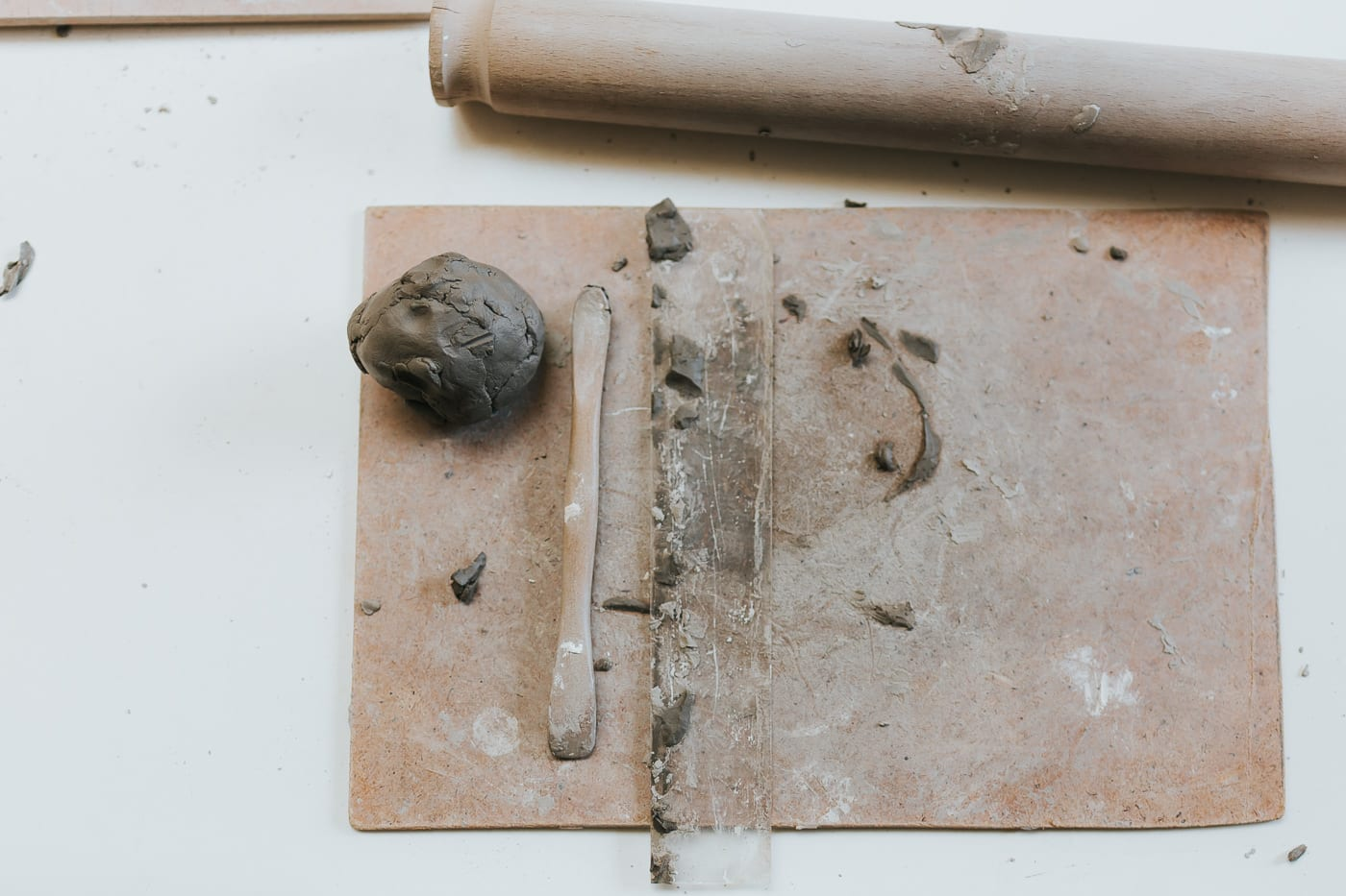 tools for shaping clay on a modelling board