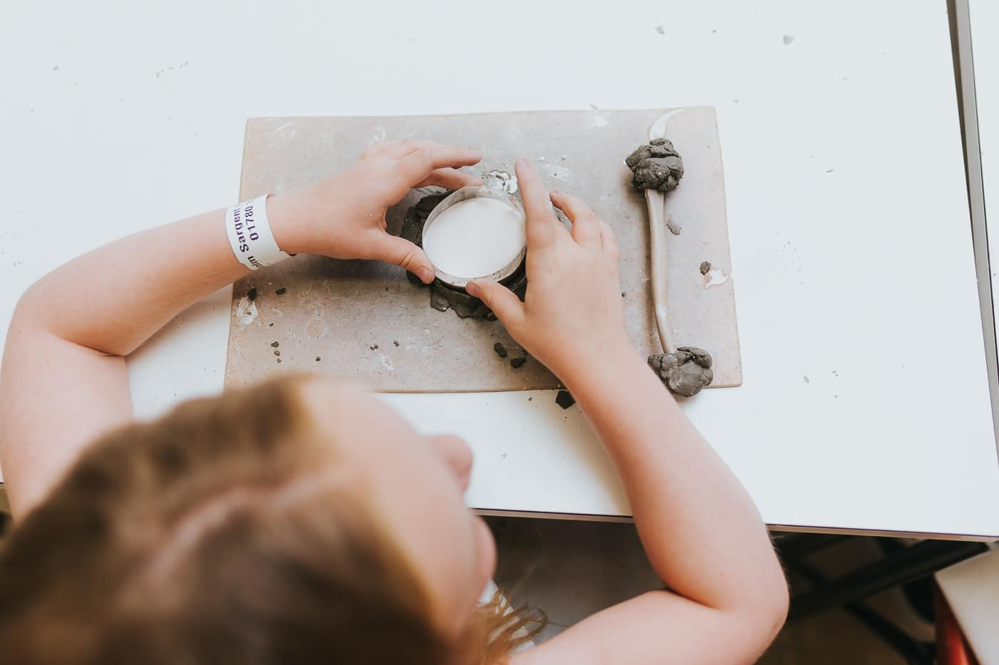 Girl holding a mould full of plaster of paris