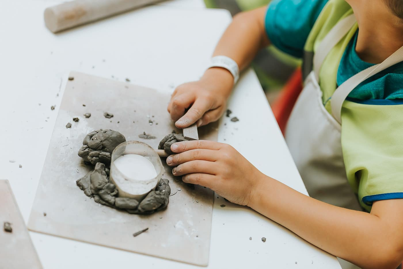 a boy shaping clay