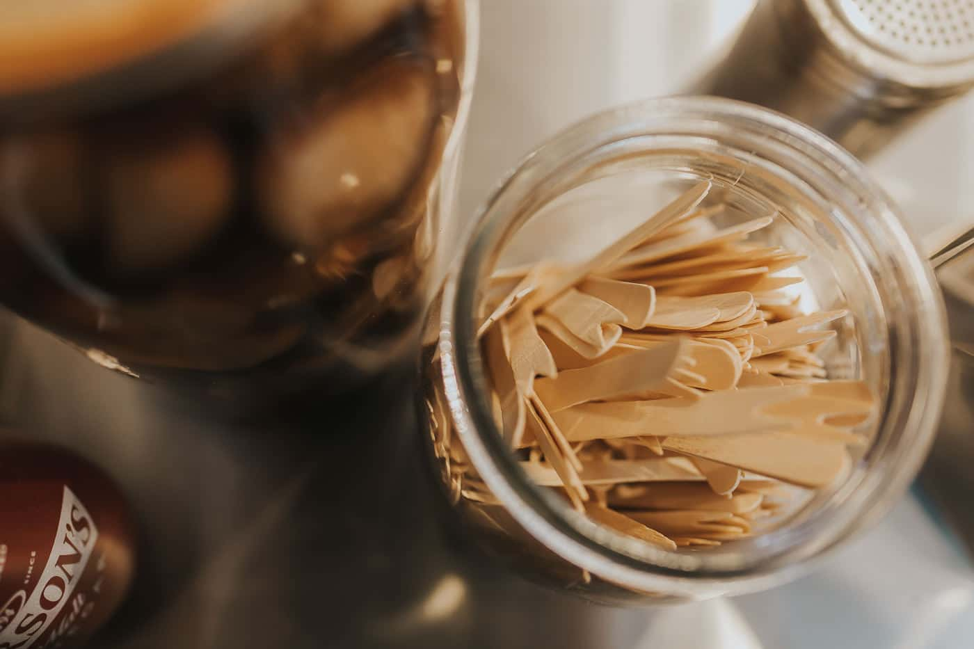 Top down view of wooden chip forks in a glass jar