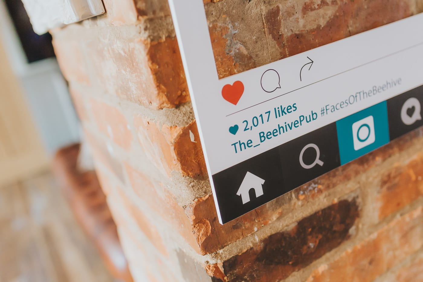 Closeup of an Instagram frame with the name of the_beehivepub shown