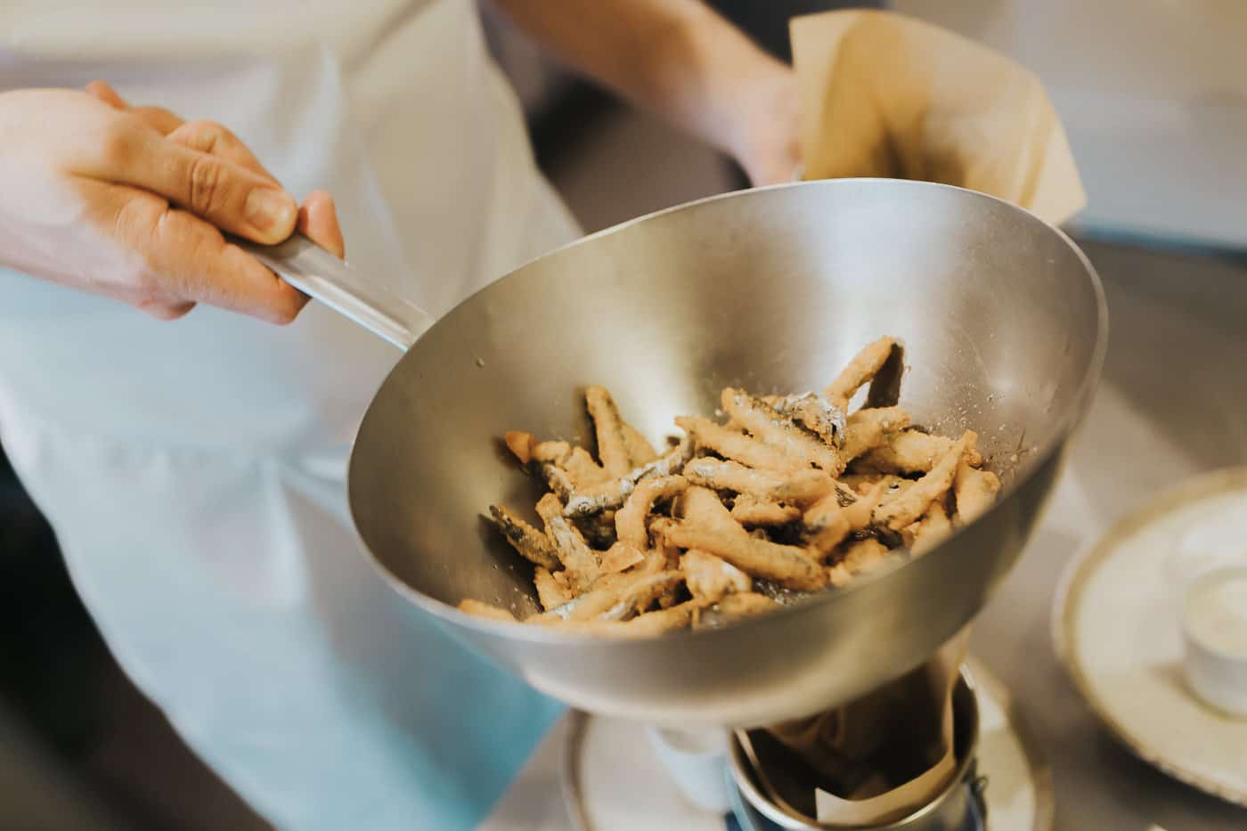 Whitebait being seasoned