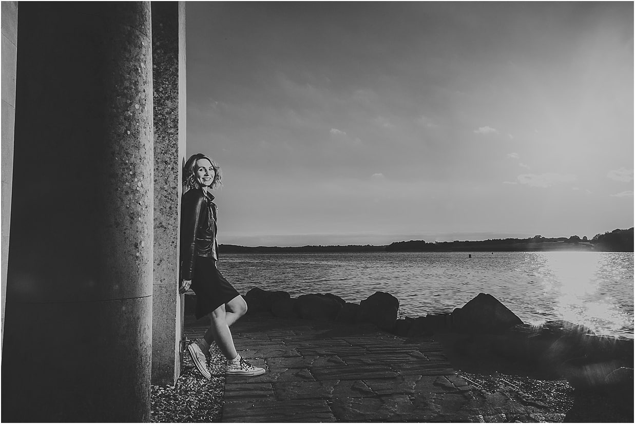 Lady leaning on Normanton church during a commercial shoot