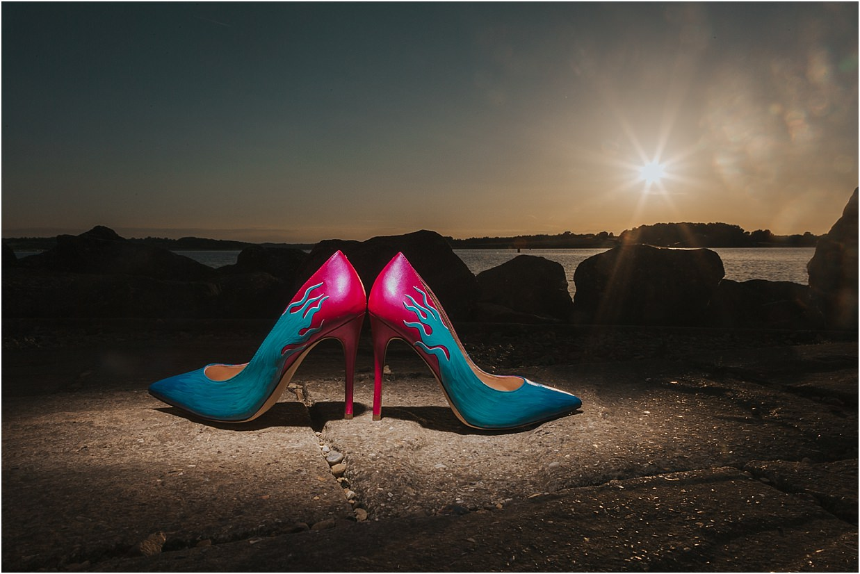 Custom made shoes lit from above with the sunset in the background