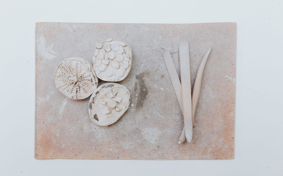 Lay flat view of three pot decorations and spatulas