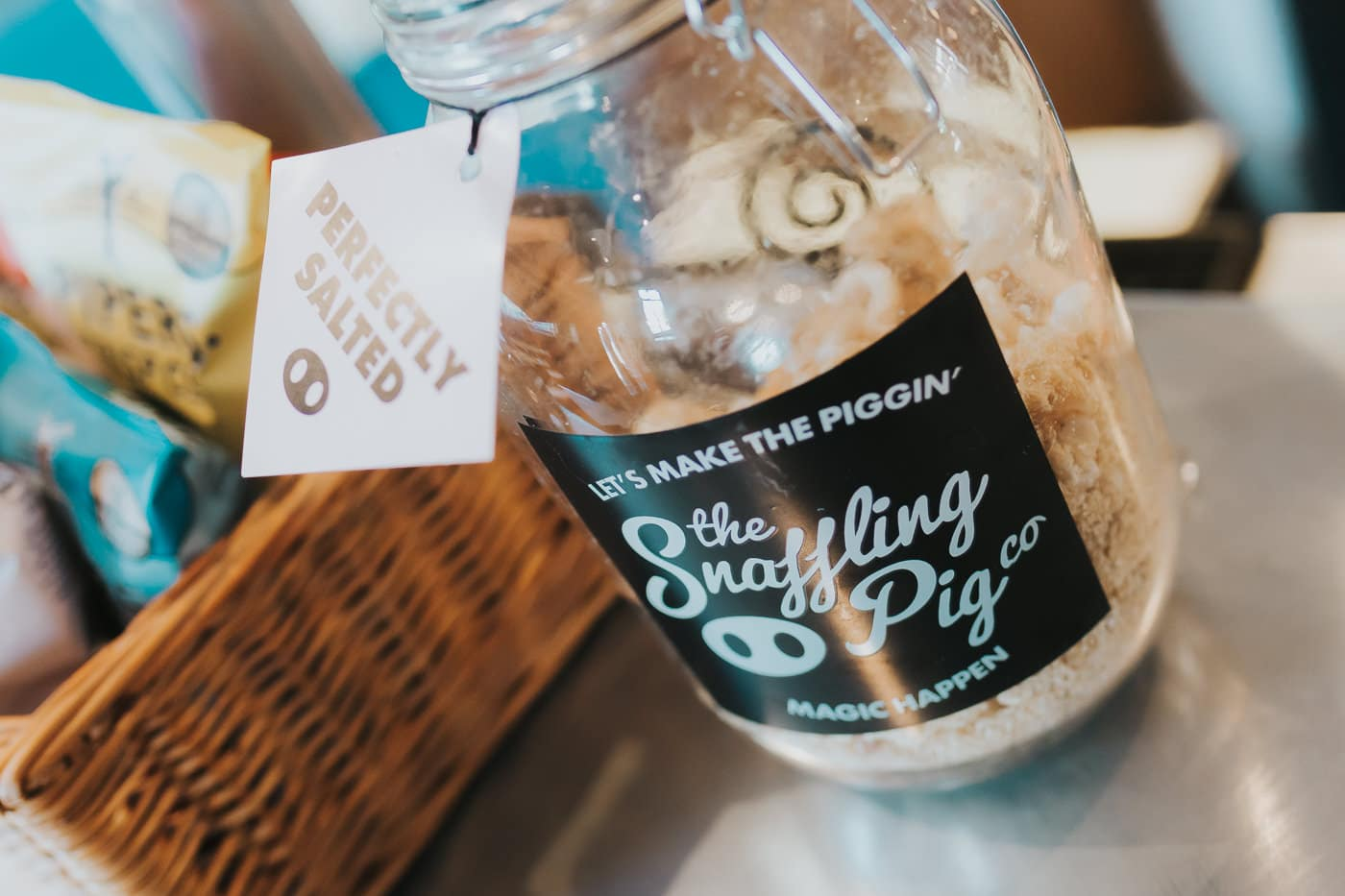 Mason jar of pork crackling, the label reads 'The Snaffling Pig'