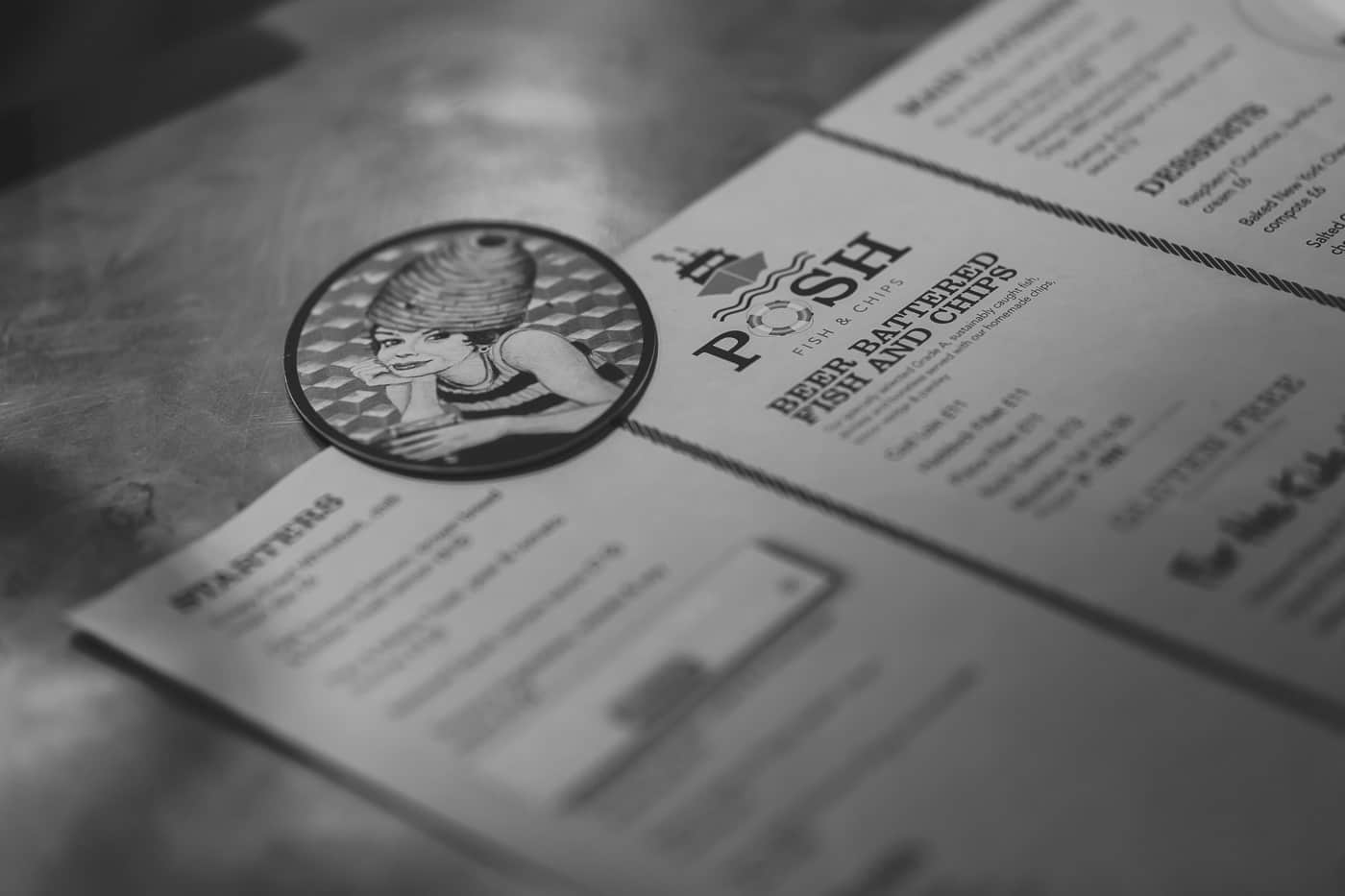 Fish and chip menu with the Beehive logo beer mat on
