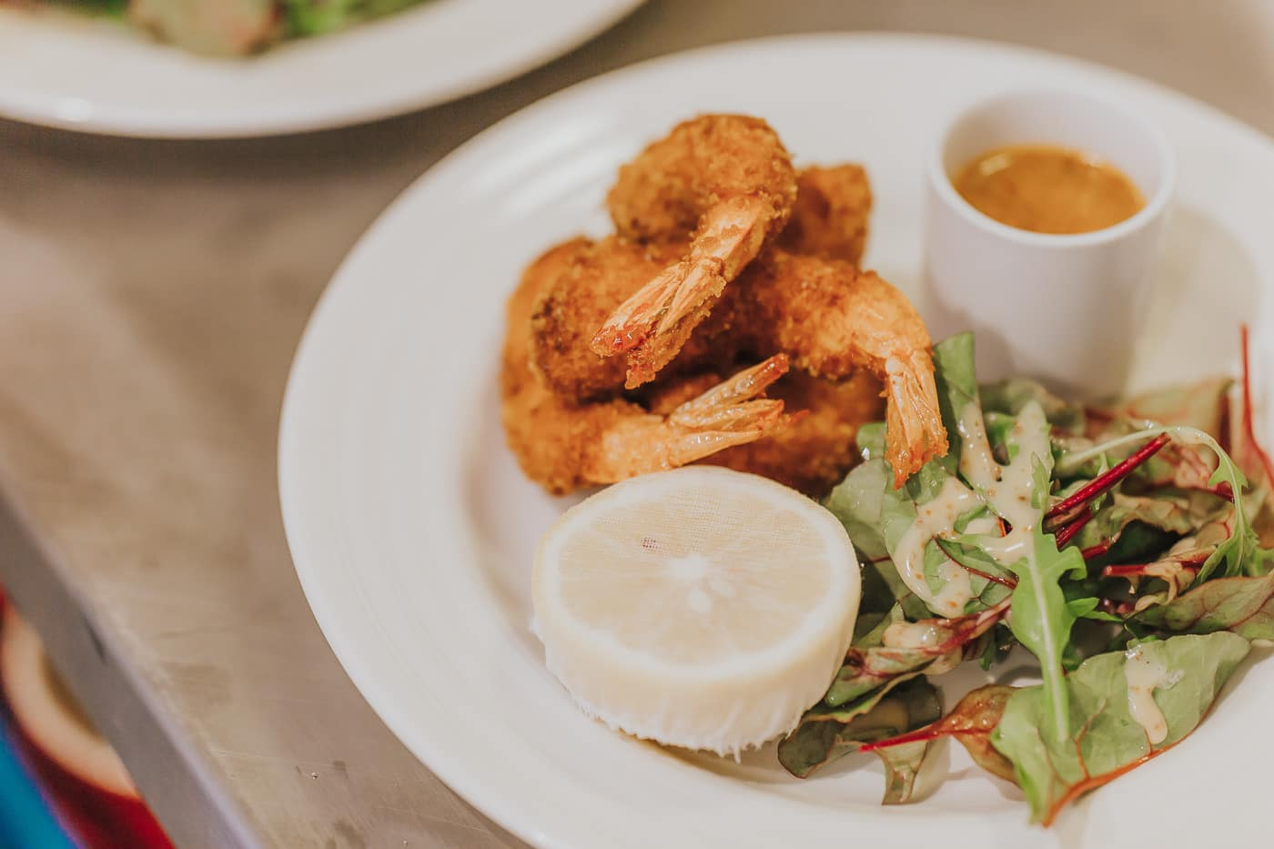 Top down shot of deep fried king prawns and salad