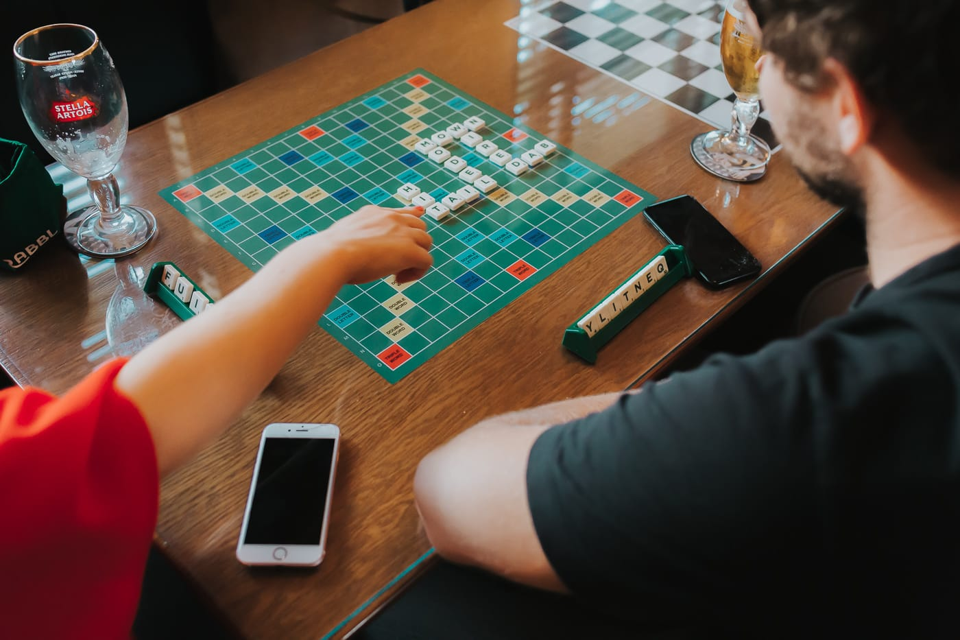 Two people playing scrabble