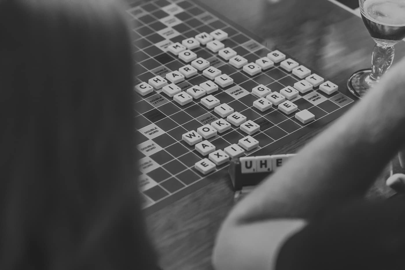 Black and white image of people playing scrabble