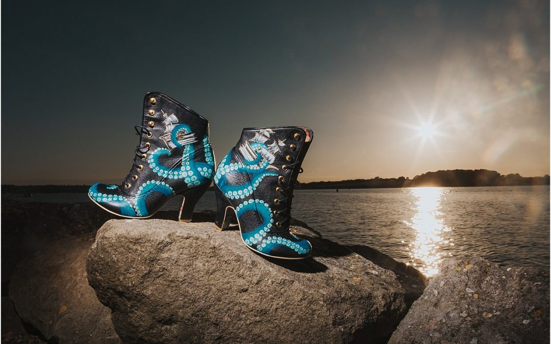 Custom designed boots with octopi on, sat on a rock in front of rutland water - Rutland commercial photographer