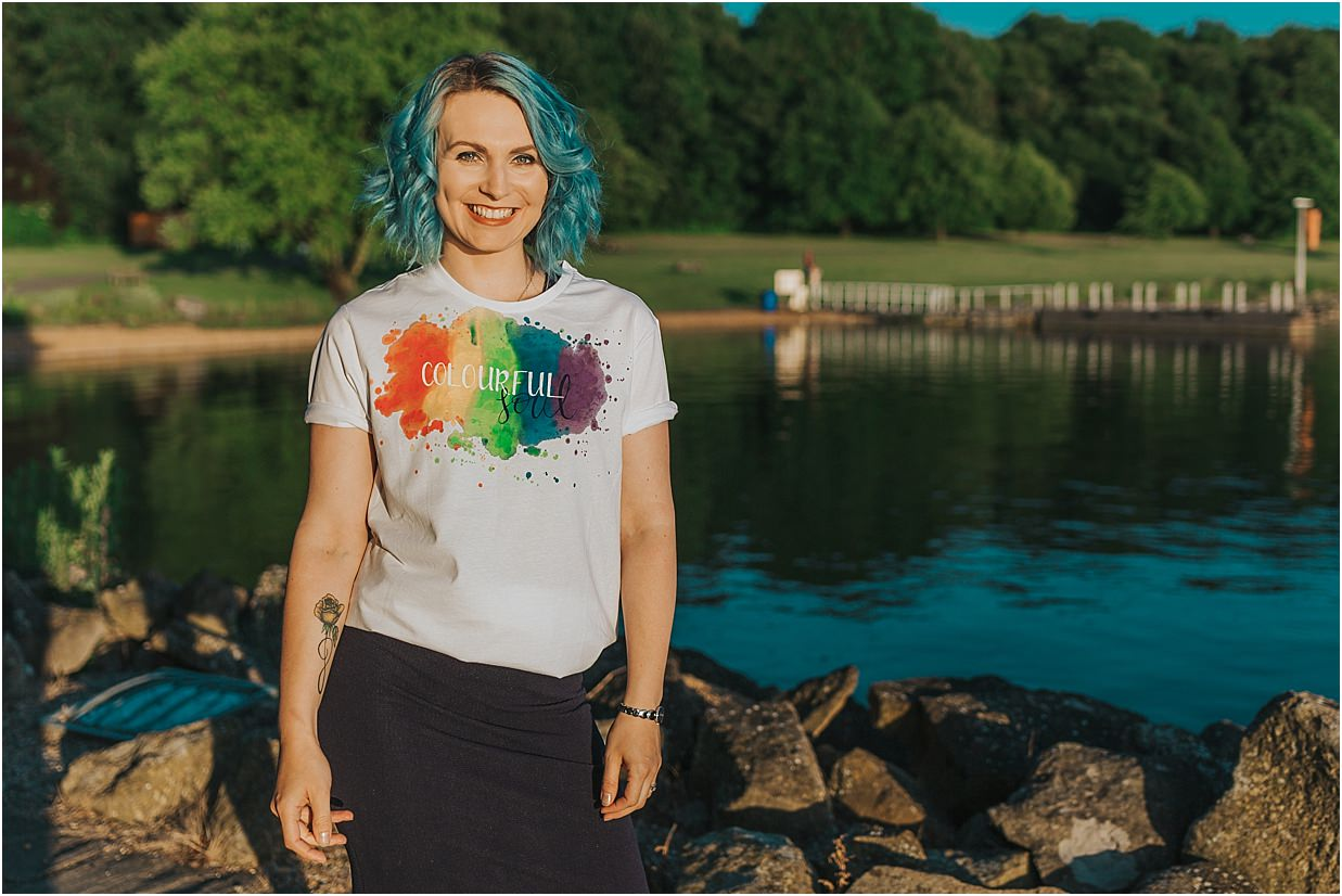 Lady wearing a 'colourful soul' tshirt in front of Rutland Water