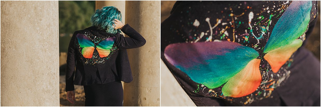 Model wearing a jacket which has been painted to look like a colourful butterfly
