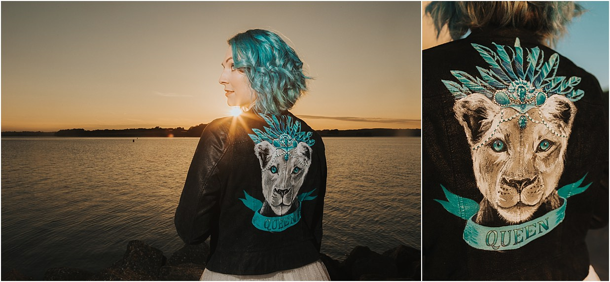 Custom designed leather jacket with a tiger head on which says 'Queen'