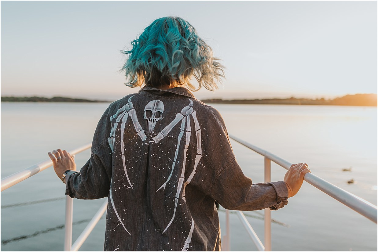 Lady with blue hair stood on the jetty at rutland water in a custom designed shirt