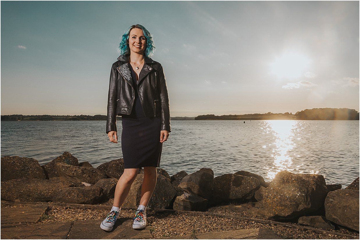 Model standing in front of Rutland Water wearing custom clothing Commercial Photography Rutland