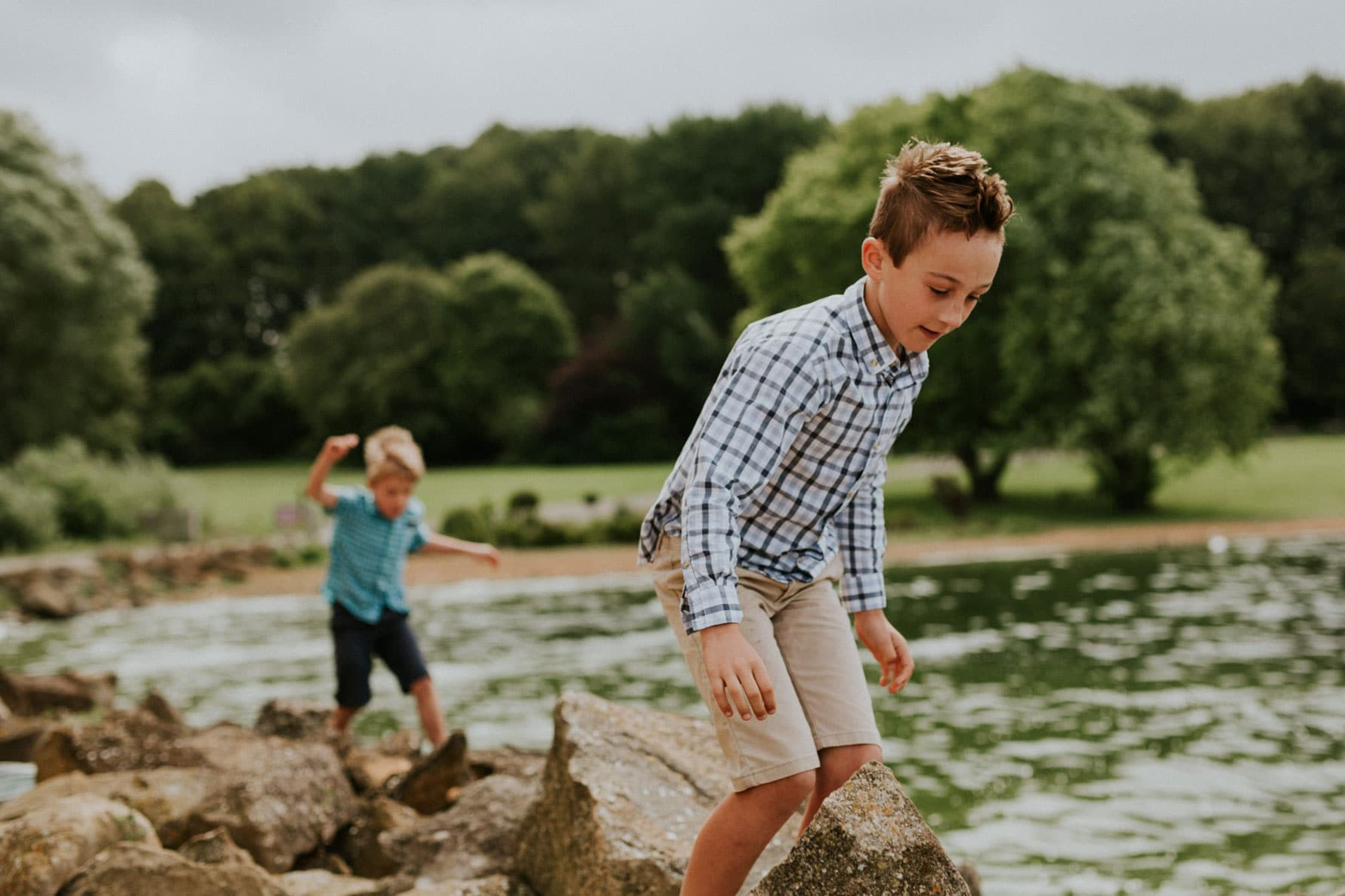 Boy walking on rocks at Normanton Church, Rutland